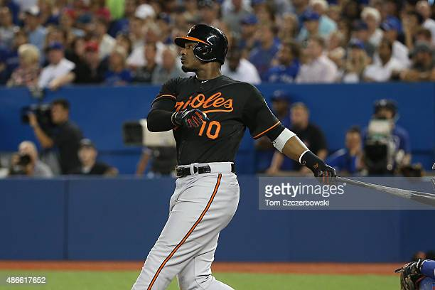 Adam Jones of the Baltimore Orioles hits a tworun home run in the eighth inning during MLB game action against the Toronto Blue Jays on September 4...