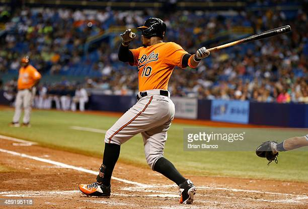 Adam Jones of the Baltimore Orioles hits an RBI single off of pitcher Erasmo Ramirez of the Tampa Bay Rays to score Chris Davis during the sixth...