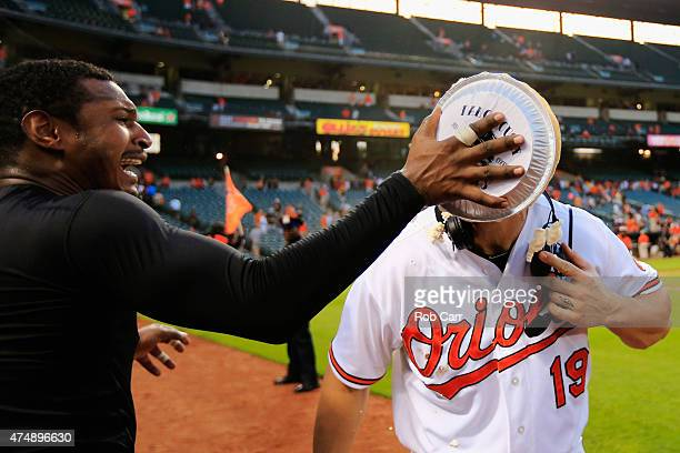Adam Jones of the Baltimore Orioles hits teammate Chris Davis in the face with a pie following the Orioles 54 win over the Houston Astros at Oriole...