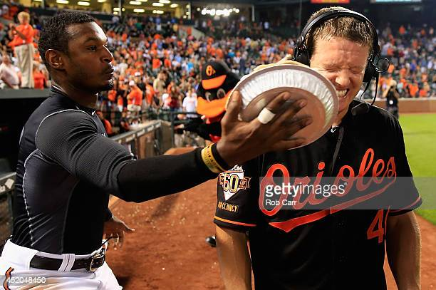Adam Jones of the Baltimore Orioles hits teammate Nick Hundley with a pie in the face after Hundley hit the game winning single to give the Orioles a...