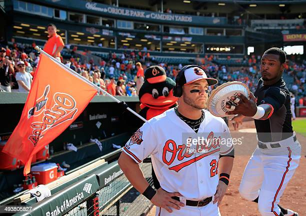 Adam Jones of the Baltimore Orioles hits teammate Steve Pearce with a pie following the Orioles 4-2 win over the Cleveland Indians at Oriole Park at...