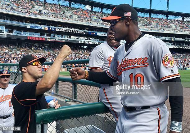 Adam Jones of the Baltimore Orioles is congratulated by Ubaldo Jimenez of the Baltimore Orioles after making a catch on a fly ball hit by Cameron...