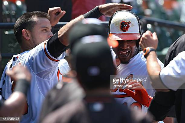 Adam Jones of the Baltimore Orioles is greeted in the dugout after hitting a solo home run in the third inning against the Oakland Athletics at...