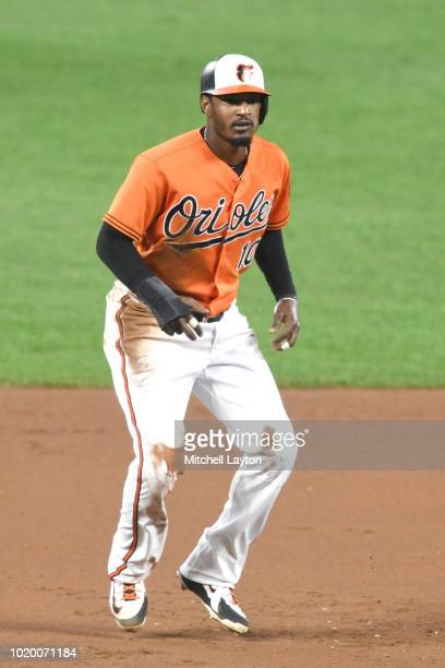 Adam Jones of the Baltimore Orioles leads off second base during game two of a doubleheader against the Boston Red Sox at Oriole Park at Camden Yards...