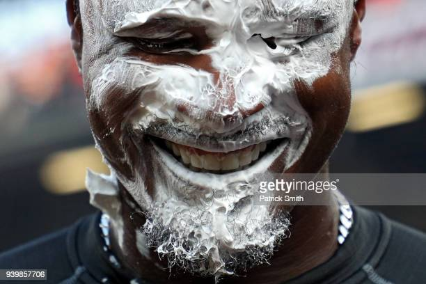Adam Jones of the Baltimore Orioles looks on after being smeared in the face with shaving cream by teammates after hitting a walkoff home run against...