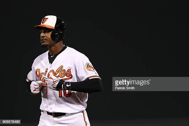 Adam Jones of the Baltimore Orioles looks on after flying out to center during the seventh inning against the Boston Red Sox at Oriole Park at Camden...