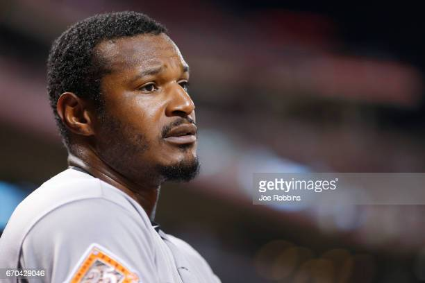 Adam Jones of the Baltimore Orioles looks on before batting in the eighth inning of the game against the Cincinnati Reds at Great American Ball Park...