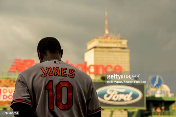 Adam Jones of the Baltimore Orioles looks on during the National Anthem before a game against the Boston Red Sox on May 2, 2017 at Fenway Park in...