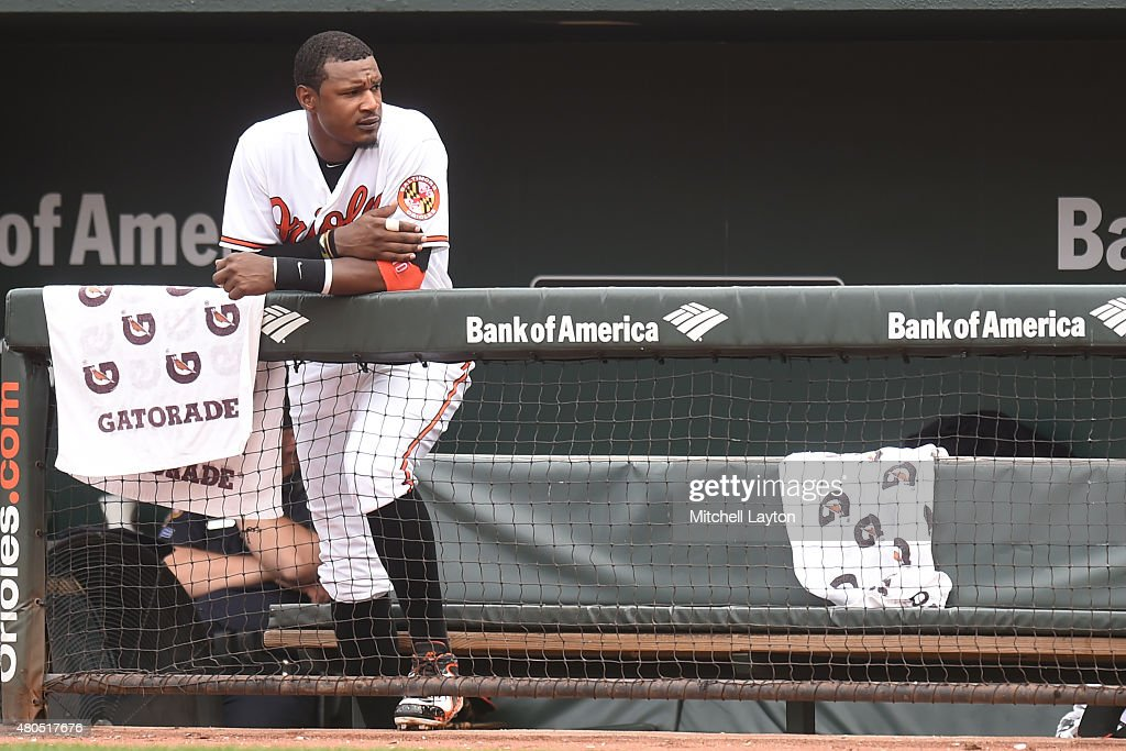 Adam Jones #10 of the Baltimore Orioles looks on from the dug out during a baseball game against the Washington Nationals at Oriole Park at Camden Yards on July 12, 2015 in Baltimore, Maryland. The Nationals won 3-2.