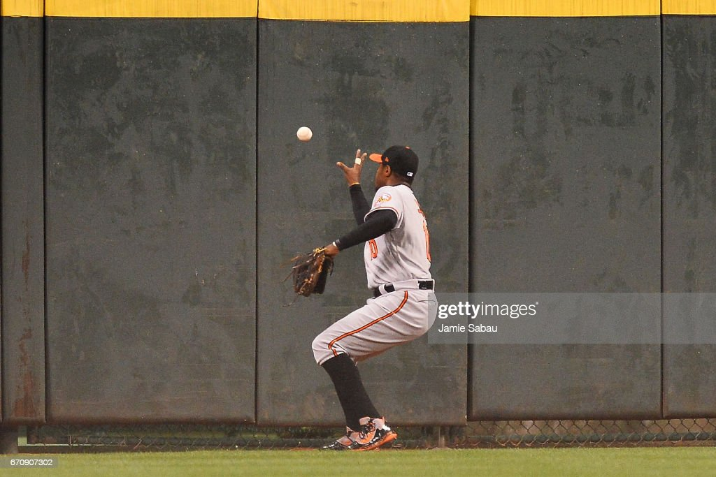 Adam Jones #10 of the Baltimore Orioles plays a ball hit off the wall by Zack Cozart of the Cincinnati Reds for a double in the eighth inning at Great American Ball Park on April 20, 2017 in Cincinnati, Ohio. Baltimore defeated Cincinnati 2-1 in 10 innings.