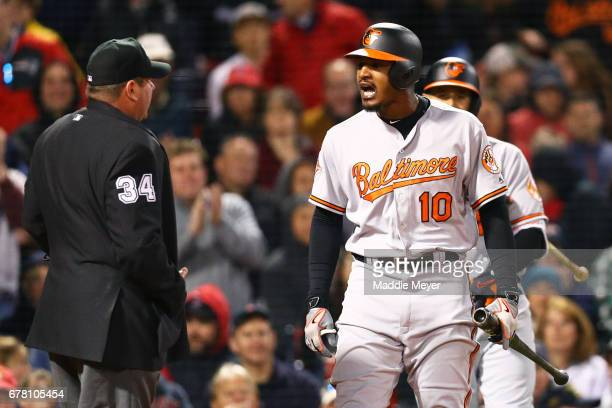 Adam Jones of the Baltimore Orioles reacts after being ejected by umpire Sam Holbrook during the fifth inning against the Boston Red Sox at Fenway...