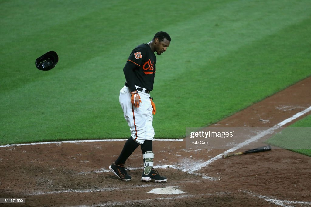 Adam Jones #10 of the Baltimore Orioles reacts after striking out for the third out of the seventh inning against the Chicago Cubs at Oriole Park at Camden Yards on July 14, 2017 in Baltimore, Maryland.