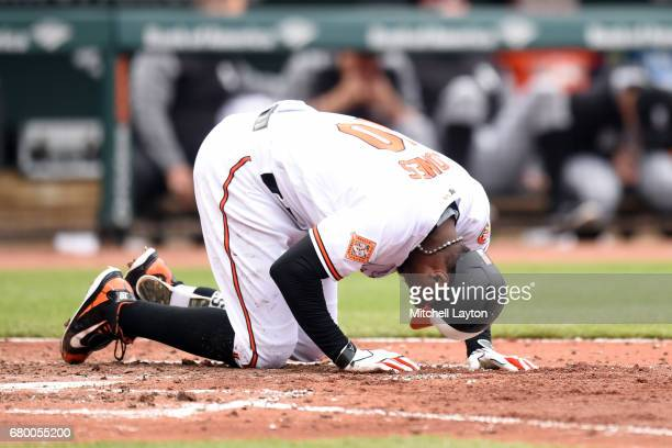 Adam Jones of the Baltimore Orioles reacts after taking a foul tip off his foot in second inning during a baseball game against the Chicago White Sox...