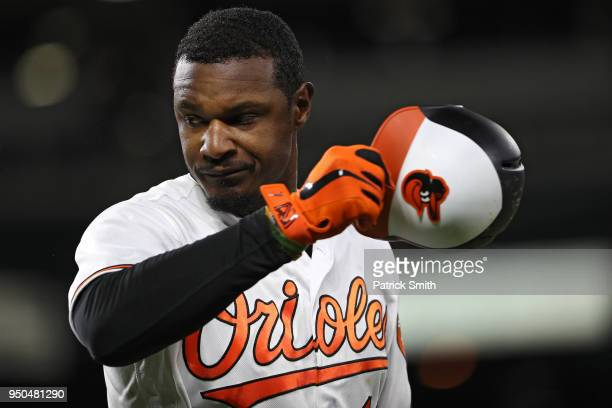 Adam Jones of the Baltimore Orioles reacts hitting an out against the Cleveland Indians during the sixth inning at Oriole Park at Camden Yards on...