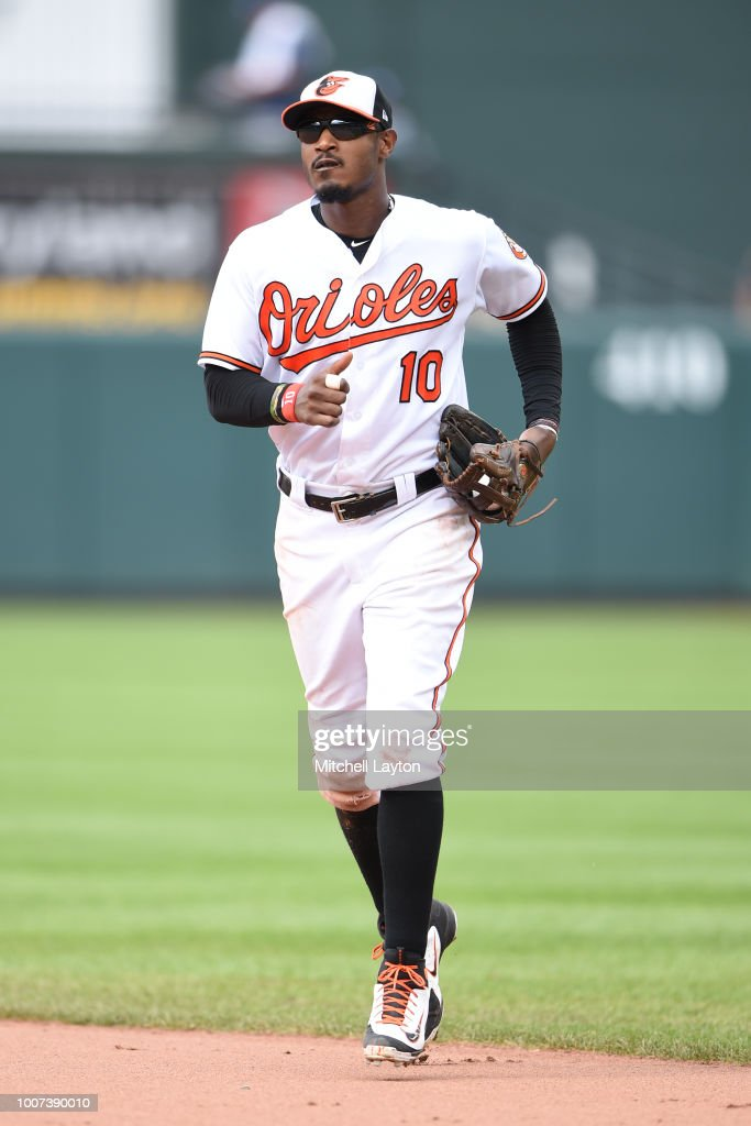 Adam Jones #10 of the Baltimore Orioles runs back to the dug out during a baseball game against the Tampa Bay Rays at Oriole Park at Camden Yards on July 29, 2018 in Baltimore, Maryland.