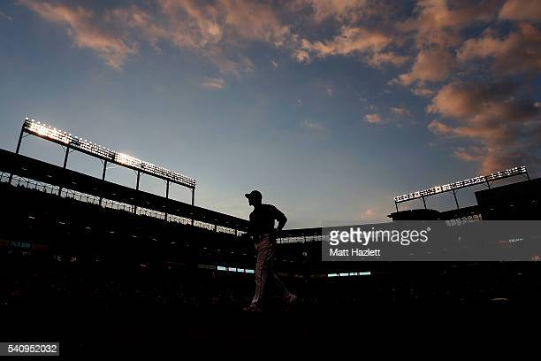 Adam Jones of the Baltimore Orioles runs off of the field in the third inning against the Toronto Blue Jays at Oriole Park at Camden Yards on June 17...