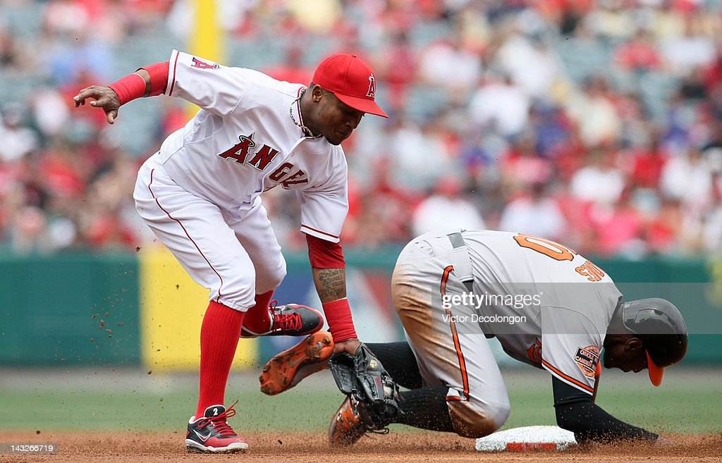 Adam Jones #10 of the Baltimore Orioles steals second base as Erick Aybar #2 of the Los Angeles Angels of Anaheim gets the tag in late in the second inning during the MLB game at Angel Stadium of Anaheim on April 22, 2012 in Anaheim, California.