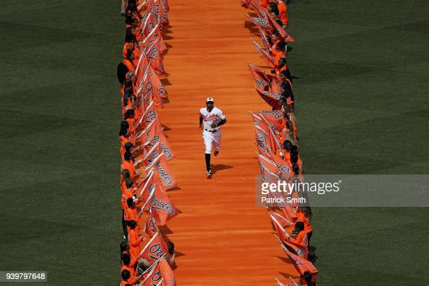 Adam Jones of the Baltimore Orioles takes the field before playing against the Minnesota Twins in their Opening Day game at Oriole Park at Camden...
