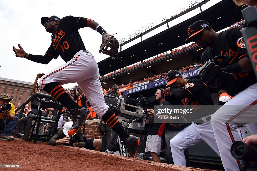 Adam Jones #10 of the Baltimore Orioles takes the field in the seventh inning against the Detroit Tigers during Game Two of the American League Division Series at Oriole Park at Camden Yards on October 3, 2014 in Baltimore, Maryland.