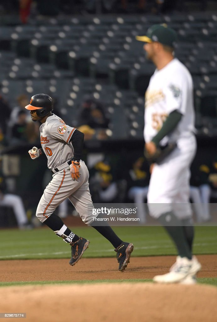 Adam Jones #10 of the Baltimore Orioles trots around the bases after hitting a solo home run off of Chris Smith #56 of the Oakland Athletics in the top of the fourth inning at Oakland Alameda Coliseum on August 10, 2017 in Oakland, California.