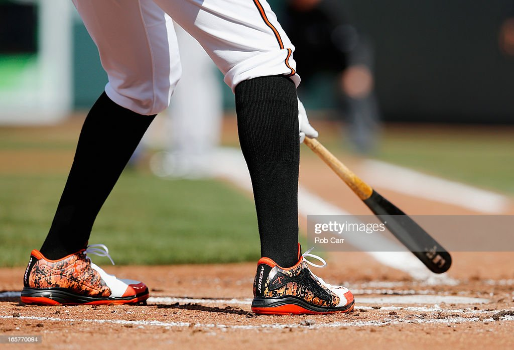 Adam Jones #10 of the Baltimore Orioles waits to bat against the Minnesota Twins during the first inning of their opening day game at Oriole Park at Camden Yards on April 5, 2013 in Baltimore, Maryland.
