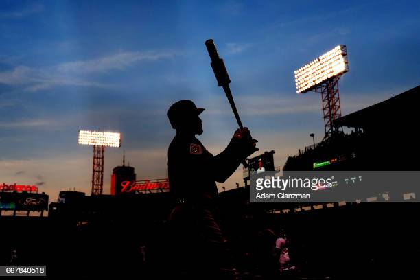 Adam Jones of the Baltimore Orioles warms up in the ondeck circle in the first inning of a game against the Boston Red Sox at Fenway Park on April 12...