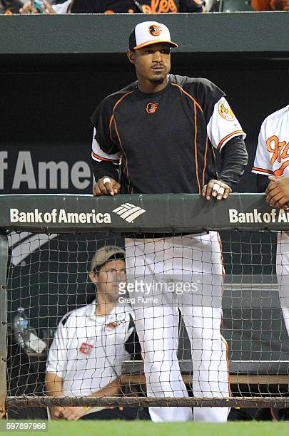 Adam Jones of the Baltimore Orioles watches the game in the ninth inning against the Toronto Blue Jays at Oriole Park at Camden Yards on August 29...