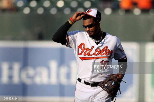 Adam Jones of the Baltimore Orioles waves to crowd after being pulled from the game in the ninth inning against the Houston Astros at Oriole Park at...