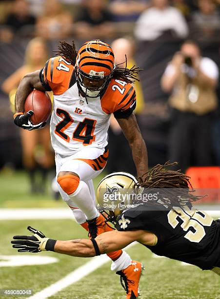 Adam Jones of the Cincinnati Bengals catches the ball as Marcus Ball of the New Orleans Saints defends during the second half at Mercedes-Benz...