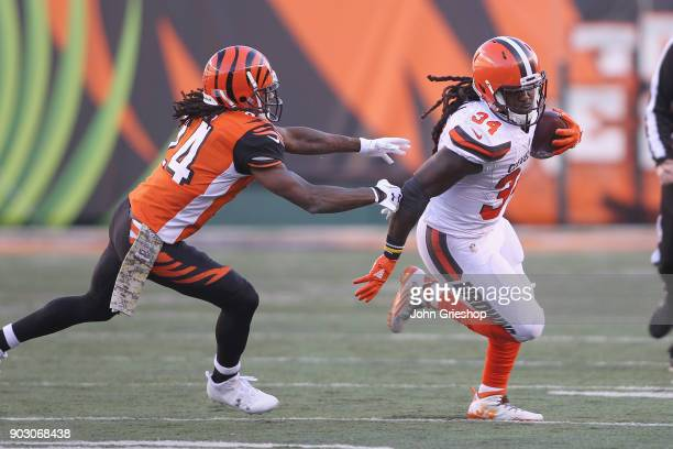 Adam Jones of the Cincinnati Bengals chases down Isaiah Crowell of the Cleveland Browns during their game at Paul Brown Stadium on November 26 2017...