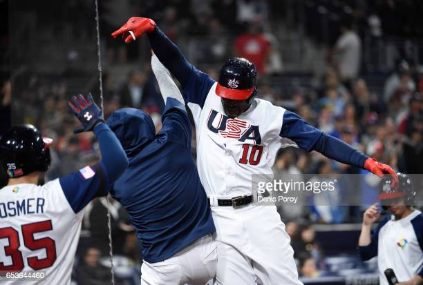 Adam Jones of the United States celebrates after hitting a solo home run in the eighth inning of the World Baseball Classic Pool F Game Two between...