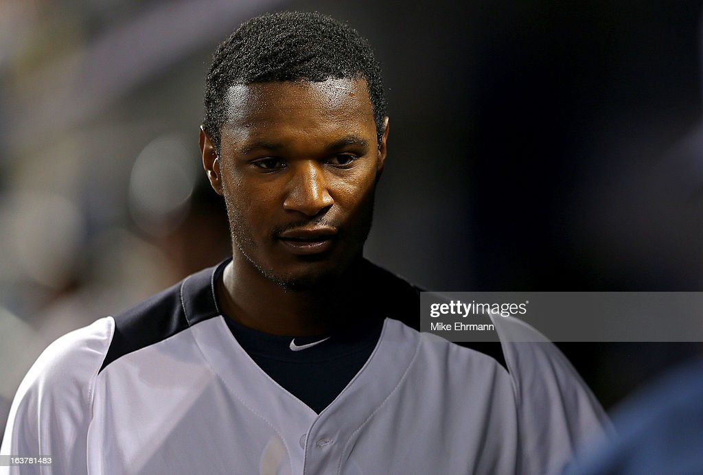 Adam Jones #10 of the United States looks on during a World Baseball Classic second round game against Puerto Rico at Marlins Park on March 15, 2013 in Miami, Florida.