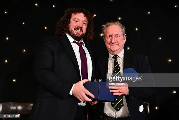 Adam Jones of Wales and Harlequins presents Bryan James with the Rugby Union Writers' Club Tankard Award during the Rugby Union Writers' Club Annual...