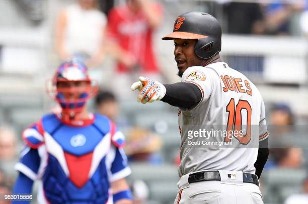 Adam Jones the Baltimore Orioles points at the Atlanta Braves dugout while hitting in the second inning at SunTrust Park on June 24 2018 in Atlanta...