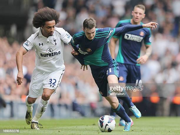 Adam Jonson of Sunderland tries to tackle Benoit AssouEkotto of Tottenham Hotspur during the Barclays Premier League match between Tottenham Hotspur...