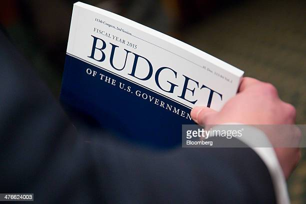 Adam Kamp with the Senate Budget Committee holds a copy of US President Barack Obama's Fiscal Year 2015 Budget in Washington DC US on Tuesday March 4...