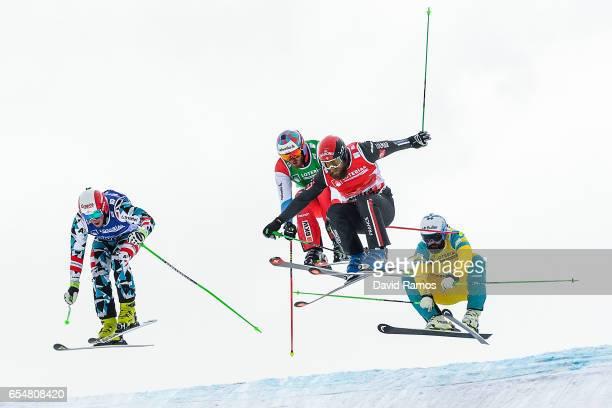 Adam Kappacher of Austria Alex Fiva of Switzerland Jonas Devouassoux of France and Anton Grimus of Australia compete in the Men's Ski Cross round of...