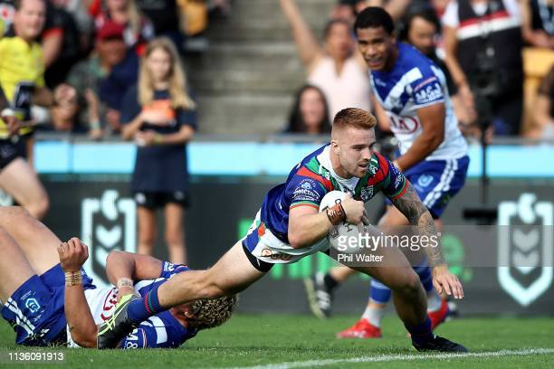 Adam Keighran of the Warriors scores a try during the round 1 NRL match between the New Zealand Warriors and the Canterbury Bulldogs at Mt Smart...