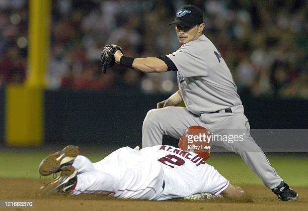 Adam Kennedy of the Anaheim Angels is tagged out stealing at second base by Russ Adams of the Toronto Blue Jays during 10 loss at Angel Stadium in...