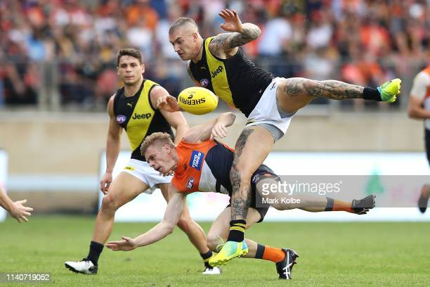 Adam Kennedy of the Giants and Dustin Martin of the Tigers compete for the ball during the round three AFL match between the Greater Western Sydney...
