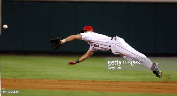 Adam Kennedy of the Los Angeles Angels of Anaheim makes a diving attempt for a line drive during 30 loss to the Oakland Athletics at Angel Stadium in...