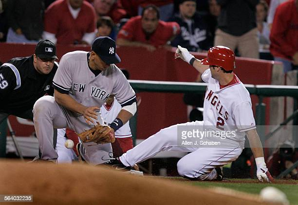Adam Kennedy triples as New York Yankees third baseman Alex Rodriguez can't make the tag during the fifth inning scoring Angels Robb Quinlan Saturday...