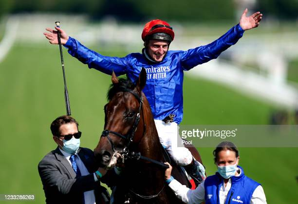 Adam Kirby celebrates on top of Adayar after winning the Cazoo Derby during day two of the Cazoo Derby Festival at Epsom Racecourse on June 5, 2021...
