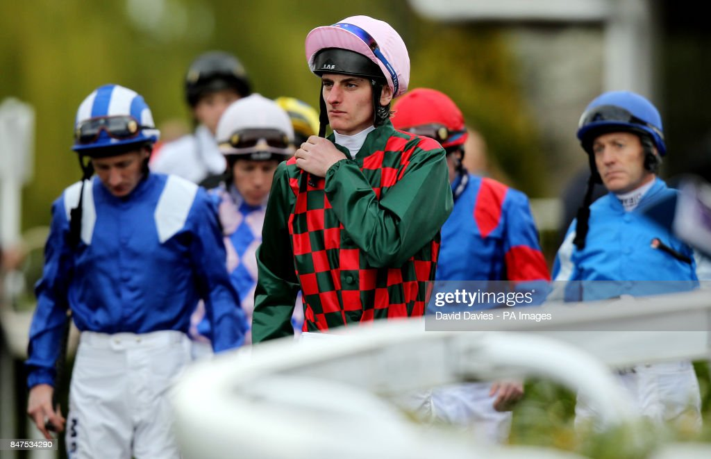 Horse racing easter family fun day kempton park racecourse adam kirby leads the jockeys out for the betfred mobile sports snowdrop fillies stakes at kempton negle Image collections