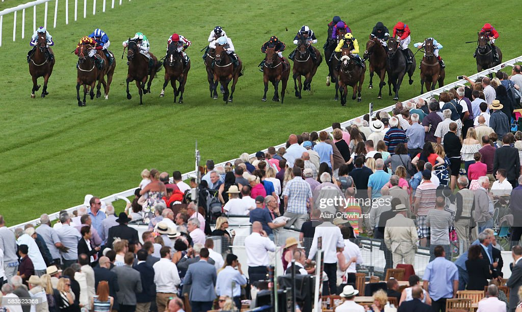 Adam Kirby riding Boom The Groom (2L, yellow) win The Weatherbys Private Bank Stakes at Goodwood on July 26, 2016 in Chichester, England.