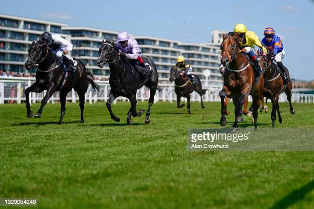 Adam Kirby riding Caturra win The IRE Incentive, It Pays To Buy Irish Rose Bowl Stakes at Newbury Racecourse on July 16, 2021 in Newbury, England....