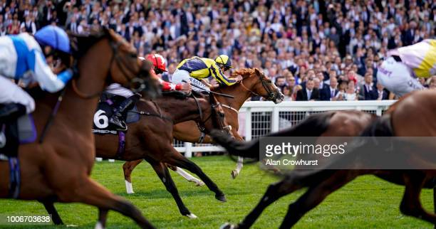 Adam Kirby riding Crack On Crack On win The Porsche Handicap Stakes at Ascot Racecourse on July 28 2018 in Ascot United Kingdom