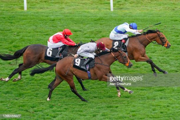 Adam Kirby riding Deise Blue win The Unibet Fillies' Novice Stakes at Newbury Racecourse on August 15 2020 in Newbury England Owners are allowed to...