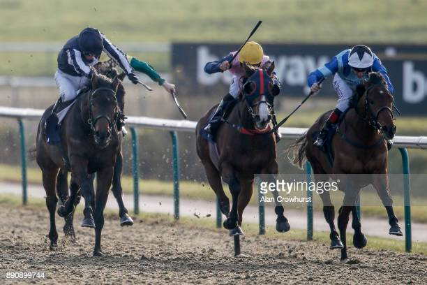 Adam Kirby riding Emenem win The Betway Casino Handicap Stakes at Lingfield Park racecourse on December 12 2017 in Lingfield United Kingdom