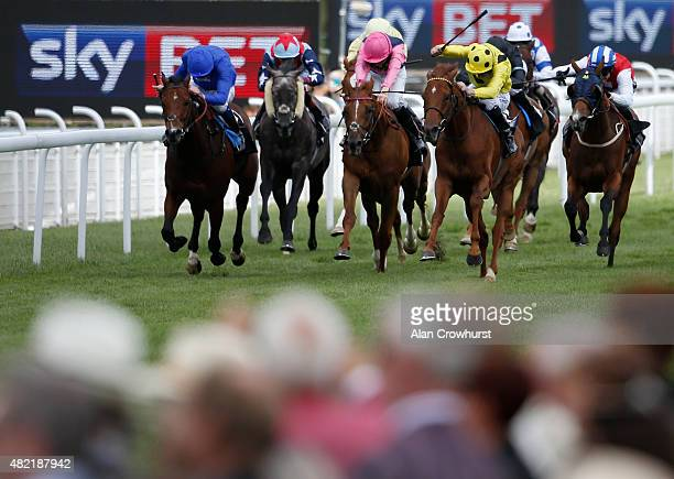 Adam Kirby riding Mount Logan win The Sky Bet First Race Special Stakes at Goodwood racecourse on July 28 2015 in Chichester England